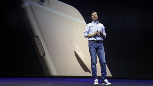 Lei Jun, founder and Chief Executive Officer of China's mobile company Xiaomi, speaks in front of a screen showing an image of an iPhone 6 Plus at a launch ceremony of the Mi Note in Beijing January 15, 2015. China's Xiaomi Inc staked its claim to Apple Inc's crown on Thursday as the world's third-biggest smartphone maker and most valuable tech start-up unveiled the flagship Mi Note, its challenger to Apple's iPhone 6 Plus.