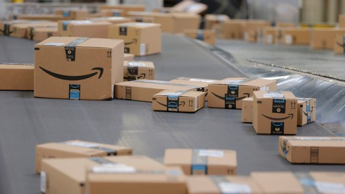 Packages emblazoned with Amazon logos travel along a conveyor belt inside of an Amazon fulfillment center in Robbinsville, New Jersey, U.S., November 27, 2017. REUTERS/Lucas Jackson - RC14C0F89150