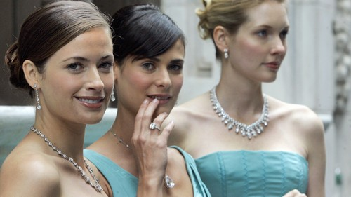 A trio of models wearing Tiffany jewelry and signature Tiffany & Co. blue dresses wait for ceremonies to begin at the opening of Tiffany's Wall Street store, Wednesday morning, Oct. 10, 2007.
