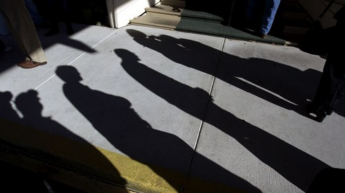 Shadows are cast as people wait in line before a campaign event for Republican presidential candidate former House Speaker Newt Gingrich at the Land's End restaurant Sunday, Jan. 15, 2012, in Georgetown, S.C. (AP Photo/David Goldman)