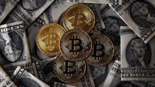 Bitcoin (virtual currency) coins placed on Dollar banknotes are seen in this illustration picture, November 6, 2017.