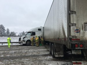 Slick Roads Cause Travel Problems Including Jackknifed Semi