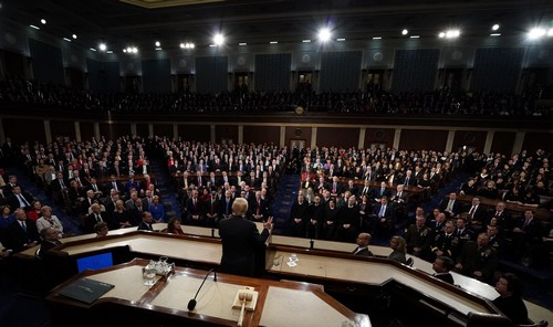 "Trump calls not applauding his State of the Union ""treason."" Photos show it's tradition"