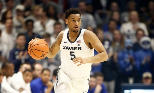 Trevon Bluiett #5 of the Xavier Musketeers dribbles the ball against the Seton Hall Pirates during the game at Cintas Center on February 14, 2018 in Cincinnati, Ohio.