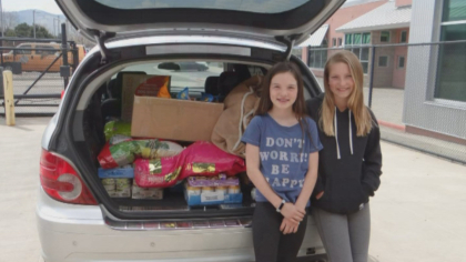 animal shelter donation 10pkg frame 1526 Girls Collect Donations To Help Feed Dogs, Cats At Animal Shelter