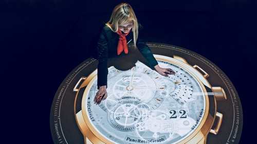 Girl fascinated by giant clock, Germany.