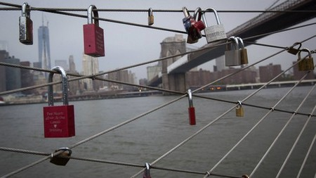 'Love locks' are seen on a fence under the Brooklyn Bridge in New York July 28, 2013. This phenomenon has increased in recent years as couples looking to publicly mark anniversaries, weddings, engagements and other significant dates affix locks to bridges and fences. 'Love locks' can be found not only in New York, but in Paris, Rome, Zurich and many other cities around the world.