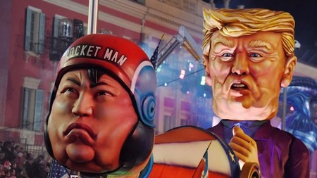 A float with effigies of North Korean leader Kim Jong Un and US president Donald Trump is paraded through the crowd during the 134th Carnival parade in Nice, France