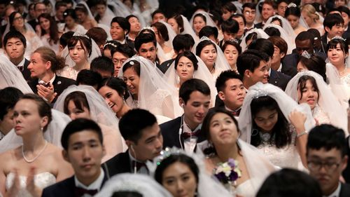 Couples from around the world attend a mass wedding ceremony at the Cheong Shim Peace World Center in Gapyeong, South Korea, Thursday, Sept. 7, 2017.