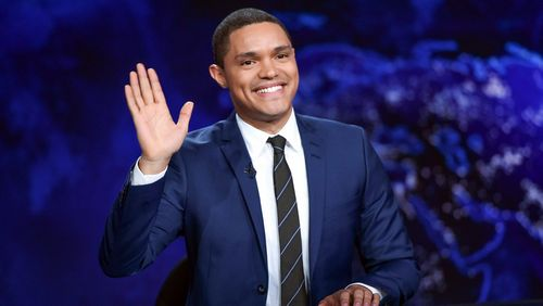 "In this Sept. 29, 2015 file photo, Trevor Noah gestures on the set during a taping of ""The Daily Show with Trevor Noah"" in New York City."