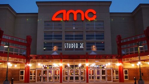 FILE - In this May 11,2005 file photo, people enter AMC's Studio 30 theater in Olathe, Kan. AMC Theatres is buying European movie theater operator Odeon & UCI Cinemas Group in a deal valued at about 921 million pounds ($1.21 billion). AMC says, Tuesday, July 12, 2016, that the transaction will make it the biggest movie theater operator in the world. Odeon & UCI has 242 theaters in Europe. The deal will give AMC a total of 627 theaters in eight countries. (AP Photo/Orlin Wagner)
