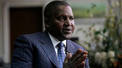 Founder and Chief Executive of the Dangote Group Aliko Dangote gestures during an interview with Reuters in his office in Lagos, June 13, 2012. Picture taken June 13, 2012 REUTERS/Akintunde Akinleye (NIGERIA - Tags: BUSINESS) - LM2E8940TNM01