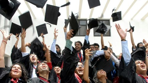 Students of the graduating class of the National Academy of Legal Studies and Research (NALSAR), University of Law, throw their caps in the air as they participate in their farewell cheer in the southern Indian city of Hyderabad.
